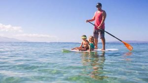 Father_and_children_paddleboarding_Worldvia