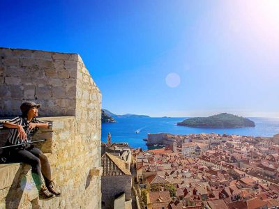 girl-sitting-on-building-croatia-worldvia